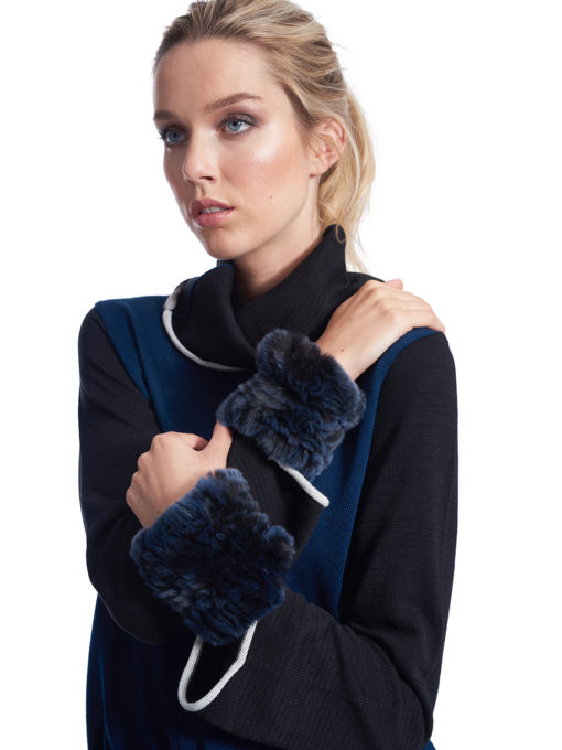 Woman wearing indigo fur cuffs